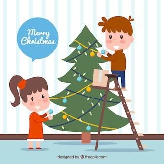 Дети, украшающие елку