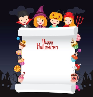 Children in halloween costume on frame decorated with sweets and candy