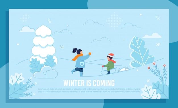 冬のあいさつ文バナーを楽しんでいる子供たち