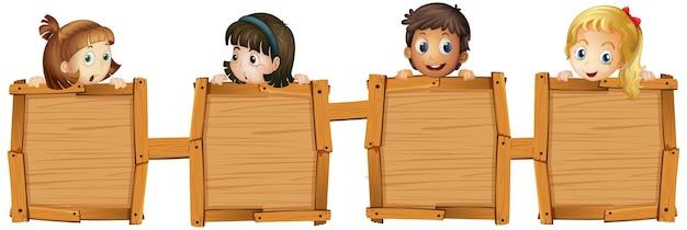 Children holding blank wooden boards