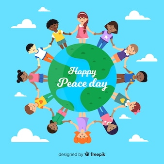 Children holding hands around the word peace day background