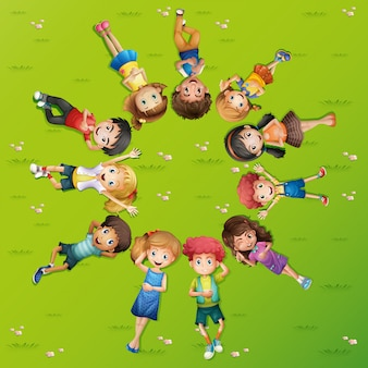 Children lying on grass in circle