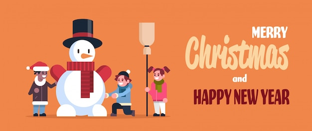 Children making snowman for a merry christmas and happy new year greeting card
