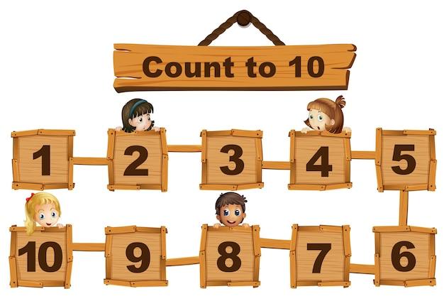 Bambini e numeri da uno a dieci su tavole di legno