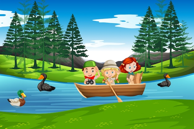 Children paddle on wooden boat