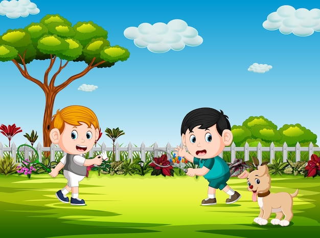 Children play badminton and the dog