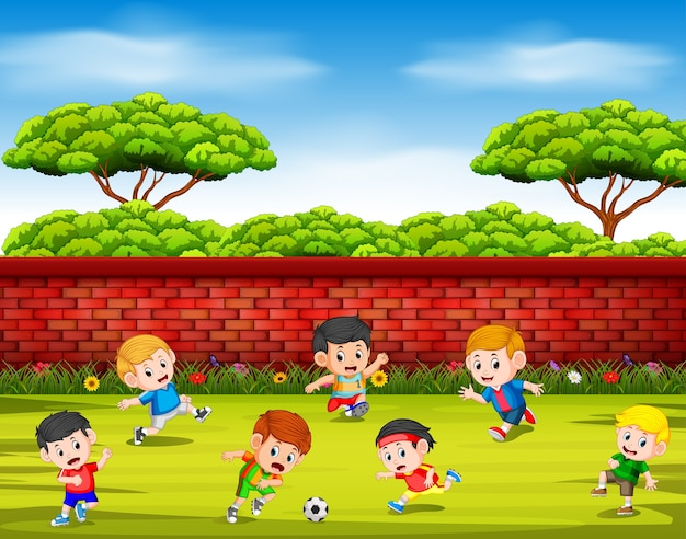 Children play soccer with their team together in the yard