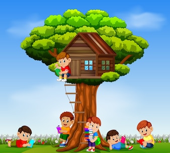 Children playing and reading the book in the garden on the tree house