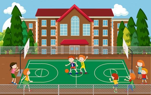 Children playing basketball scene