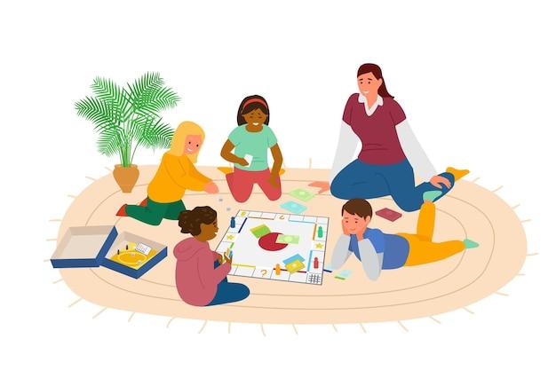Дети играют в настольную игру на полу в детском саду