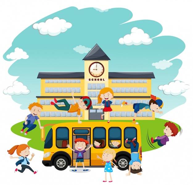 Children playing in front of school and bus