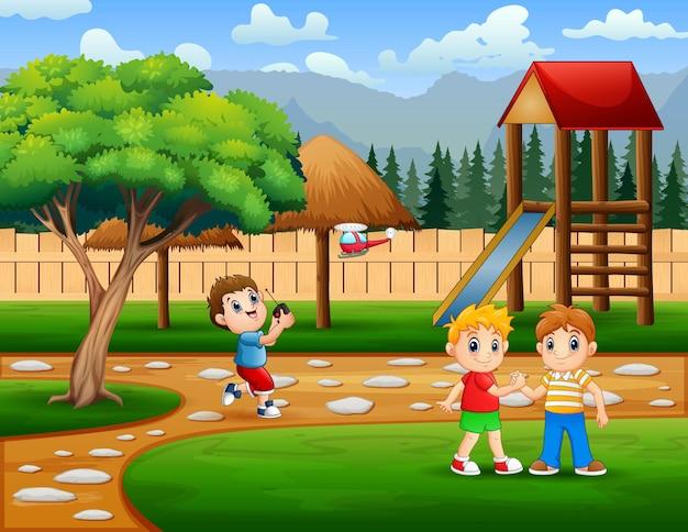 公園のイラストで遊ぶ子供たち
