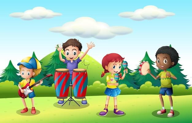 公園で音楽を演奏する子供たち