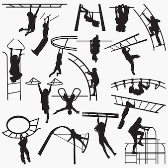Children playing on playground monkey bars silhouettes