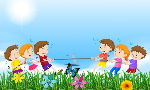 Children playing tug o war in the field