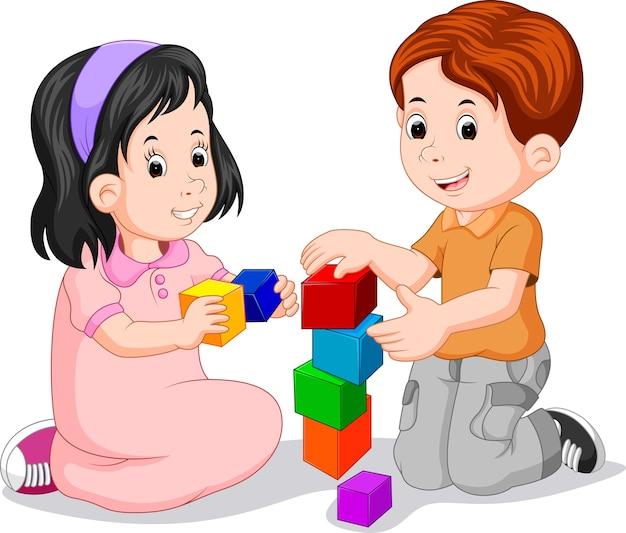 キューブで遊ぶ子供たち