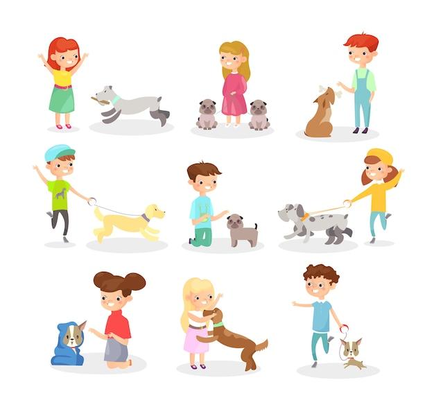강아지와 함께 노는 아이들. 개, 애완 동물을 가지고 노는 행복한 소년과 소녀