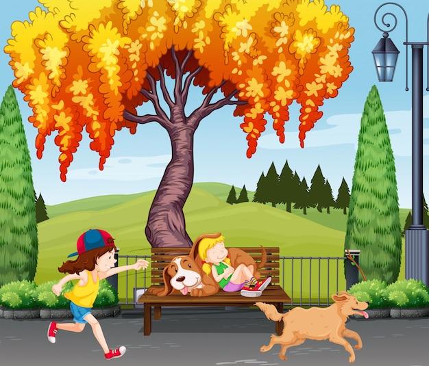 犬で遊んでいる子供たち
