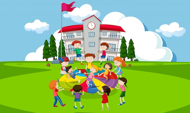 Children playing with a parachute infront of school