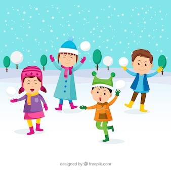 雪の球で遊ぶ子供たち