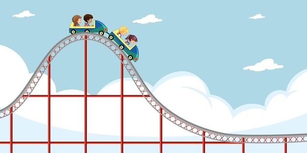 Children ride roller coaster on sky