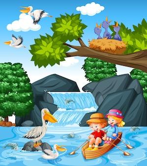 子供たちは小川の森のシーンでボートを漕ぐ