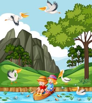 子供たちは小川の森でボートを漕ぐ