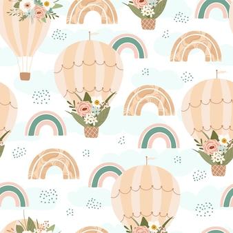 パステルカラーの春の虹、気球、鳥と花と子供のシームレスなパターン。キッズルームのデザイン、壁紙、テキスタイル、包装紙、アパレルのかわいいテクスチャ。ベクトルイラスト