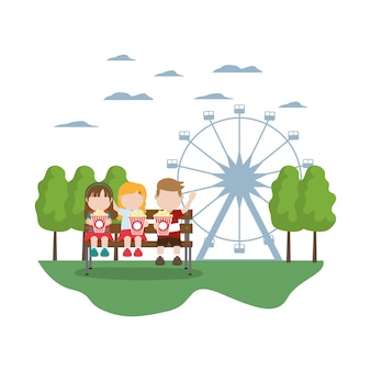 Children seating and eat popcorn in the carnival