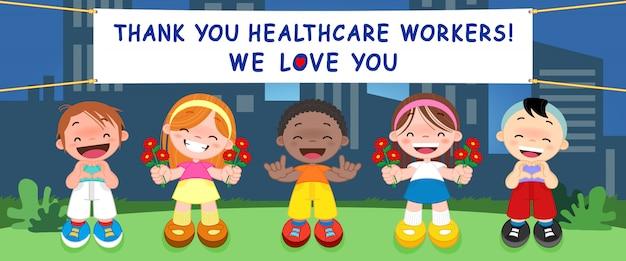 子供たちは、病院で働いてコロナウイルスと闘う医師、看護師、医療人事チームに感謝の意を表します(covid-19)
