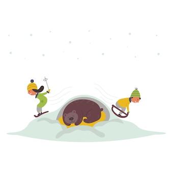 スライド冬を滑る子供たち