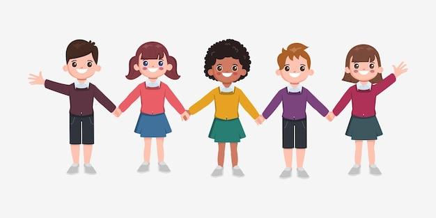 笑顔で手をつないでいる子供たち