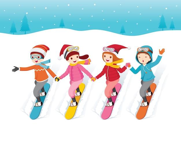 Дети вместе катаются на сноуборде