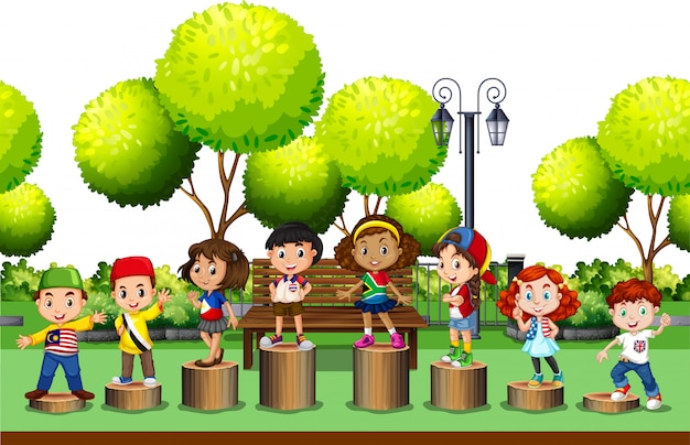 Children standing on log in the park