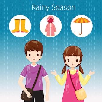 雨の中で一緒に立っている子供たち、体が濡れている、梅雨の季節