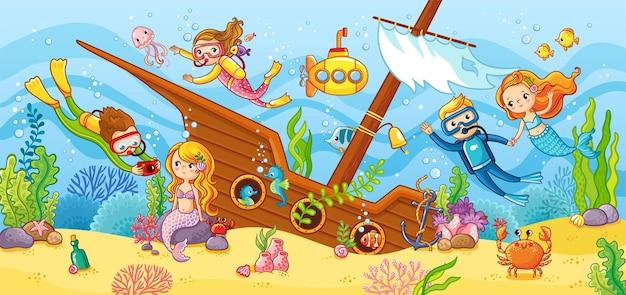 子供たちは難破船でスキューバダイビングで泳ぐ