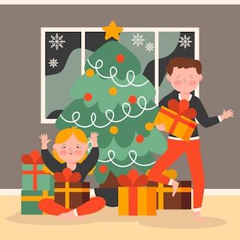 クリスマスプレゼントを箱から出す子供たち