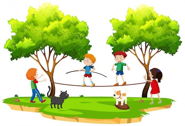 Children walking tightrope in the park