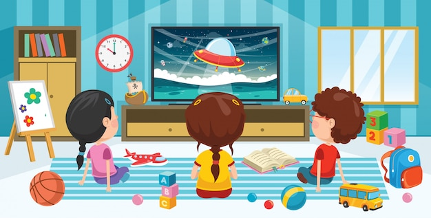 Children watching television in  a room