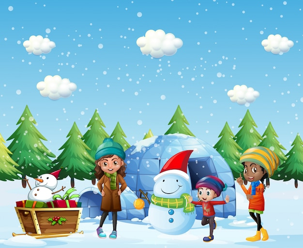 Children with igloo and snowman in winter