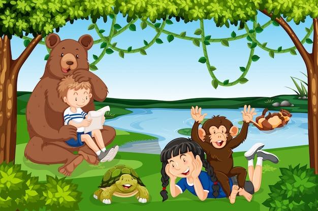 Children with wild animals scene