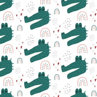 Childrens handdrawn seamless pattern with a crocodile crocodile rainbow and hearts pattern