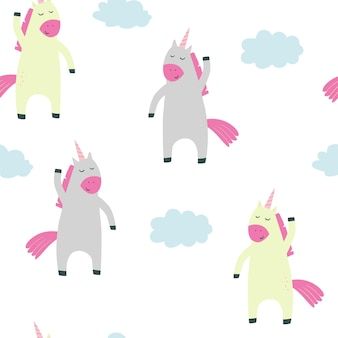 Childrens pattern with unicorns clouds vector seamless pattern for children