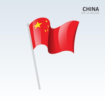 Развевающийся флаг китая, изолированные на серый