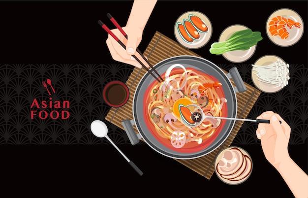 Китайский горячий горшок азиатская еда, есть шабу шабу и сукияки в горячем горшке