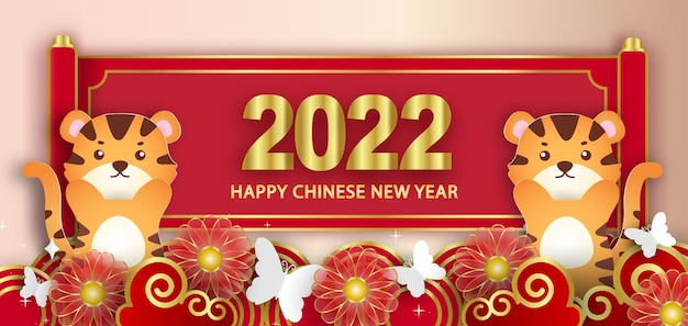 Chinese new year 2022 year of the tiger banner in paper cut style.