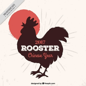 Chinese new year background with rooster silhouette