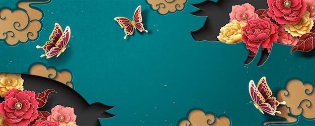 牡丹の花と貯金箱の形の中空、ターコイズブルーの背景を持つ中国の旧正月バナーテンプレート