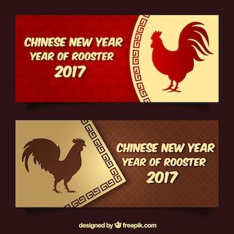 雄鶏のシルエットを持つ中国の新年のバナー