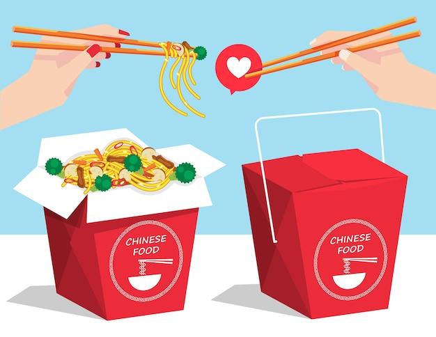 男と女の手が箸を持っているテーブルの上の中華麺料理の持ち帰り用の箱。